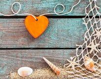 Оранжевое сердце с морской темой Стоковая Фотография