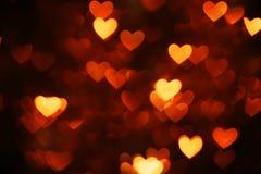 Оранжевое bokeh сердца Стоковая Фотография