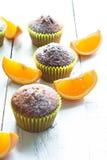 Оранжевые булочки на таблице Стоковая Фотография