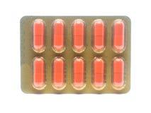 Оранжевые пилюльки капсул желатина цвета в пакете волдыря Стоковая Фотография RF