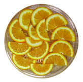 Оранжевые половинные куски на блюде Стоковое Фото