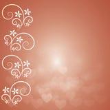 Оранжевые предпосылка с сердцем bokeh и флористический Стоковые Изображения