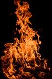 Оранжевые пламена огня изолированные на черной предпосылке Стоковое Фото