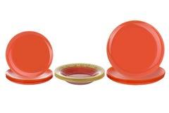 Оранжевые плиты на белой предпосылке Стоковое фото RF