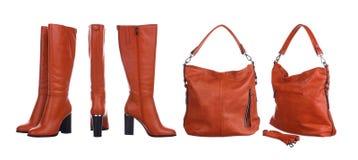 Оранжевые сумка и ботинки стоковые фото