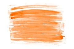 Оранжевый абстрактный дизайн хода акварели на бумажной текстуре стоковое фото
