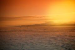 Оранжевый восход солнца на Lake Baikal в зиме Стоковая Фотография RF