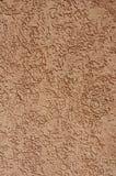 Оранжевый гипсолит сброса на крупном плане стены Стоковое Фото