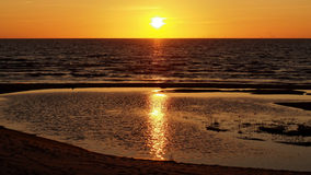 Оранжевый заход солнца на Балтийском море Стоковое Фото
