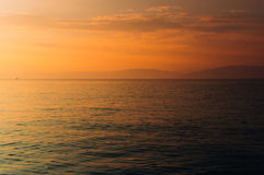 Оранжевый заход солнца океана Стоковые Изображения RF