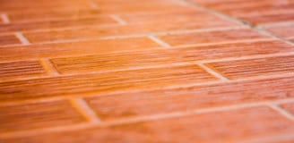 Оранжевый керамический плиточный пол. Стоковые Фотографии RF