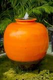 Оранжевый опарник фонтана Стоковое Изображение