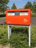 Оранжевый почтовый ящик PostNL Стоковое фото RF