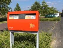 Оранжевый почтовый ящик PostNL Стоковая Фотография RF