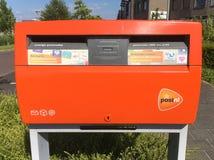 Оранжевый почтовый ящик PostNL Стоковые Изображения