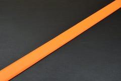 Оранжевый пояс на черной предпосылке Стоковая Фотография RF