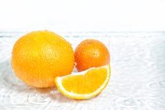 Оранжевый плодоовощ в разделе в белой воде Стоковые Изображения RF