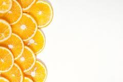 Оранжевый плодоовощ в разделе в белой воде Стоковые Изображения