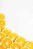 Оранжевый плодоовощ в разделе в белой воде Стоковая Фотография RF