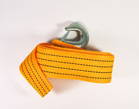 Оранжевый ремень отбуксировки Закройте вверх крюков веревочки отбуксировки Комплект инструмента для изменять автошины автомобиля Стоковое Фото