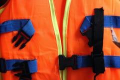 Оранжевый спасательный жилет Стоковая Фотография