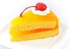 Оранжевый торт с вишней Стоковые Фото