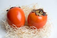 2 оранжевых хурмы стоковая фотография