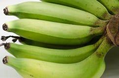 Органический зеленый банан Стоковые Изображения