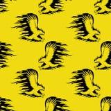 Орел огня на желтой предпосылке Стоковое фото RF
