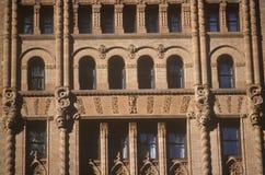 Орнаментальные окна, Уолл-Стрит, город NY, NY Стоковые Изображения RF