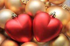 Орнаменты рождества красного сердца форменные Стоковое Изображение
