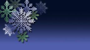 Орнаменты снежинки рождества против голубой предпосылки Стоковые Изображения RF