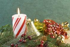 орнамент золота рождества свечки колокола Стоковая Фотография