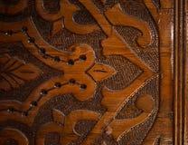 Орнамент на темной древесине Стоковое фото RF