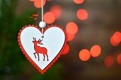 Орнамент рождества и запачканные красные света рождества Стоковые Фото