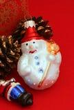 Орнамент рождества снеговика на красном цвете Стоковое Фото