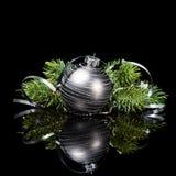 Орнамент рождества с ветвями сосны на черной предпосылке Стоковые Изображения