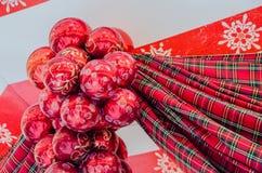 Орнамент рождества с красной лентой Стоковое Фото