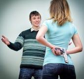 Оружие женщины пряча Стоковое Фото
