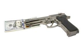 Оружие и деньги Стоковая Фотография