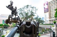 Оружие полдня на гостинице 1881 наследия в Tsim Sha Tsui, Kowloon, Гонконге Стоковое Изображение RF