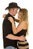 Оружия ковбоя вокруг голов женщины закрывают стоковое изображение