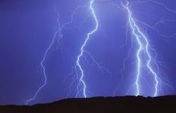Освещать в голубом небе Стоковое Фото