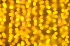 освещение предпосылки золотистое Стоковые Фотографии RF