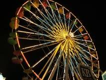 Освещенное колесо Ferris на ноче стоковая фотография