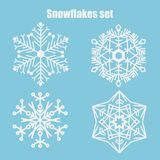 Vector set of snowflakes on a blue background. royalty free illustration