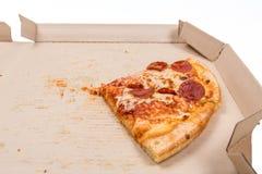 Остаток пицца в коробке стоковая фотография rf