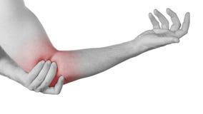 Острая боль в локте человека. Стоковое Изображение