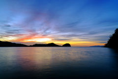 Острова Togean на заходе солнца Индонезия Стоковое Фото
