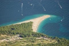 остров плащи-накидк brac золотистый стоковые изображения
